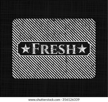 Fresh chalkboard emblem written on a blackboard