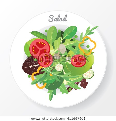 Fresh vegetable and green leaf salad dish.
