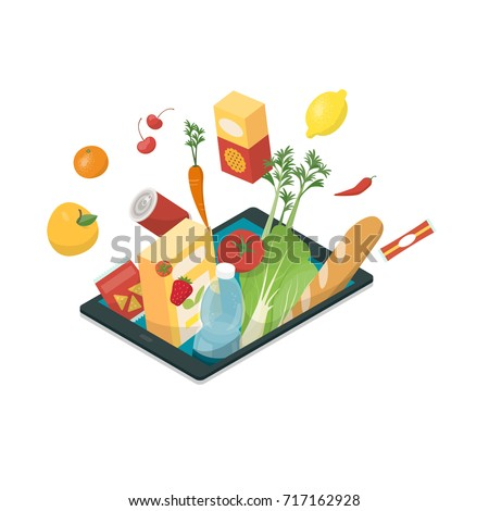 Fresh vegetables and grocery products bursting from a digital tablet, online grocery shopping and food app concept
