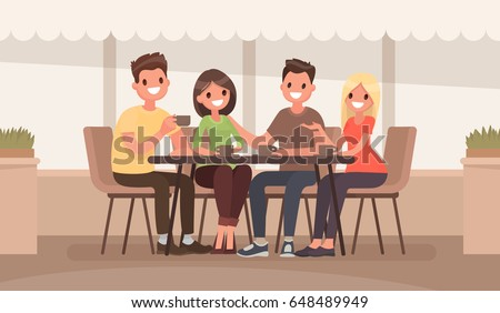 friends are sitting at a table