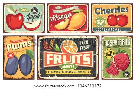 Fruit market vintage signs collection. Apple, mango, cherry, orange, plum and raspberry retro posters set. Fruit plantation and farm vectors and sign labels.