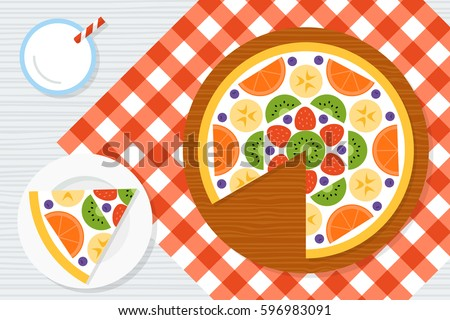 fruit pizza on a red checkered