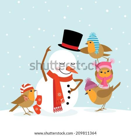 Funny Robins birds making a snowman.