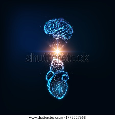 Futuristic emotional intelligence concept with glowing low polygonal human brain and heart and light energy between them isolated on dark blue background. Modern wire frame design vector illustration. Photo stock ©