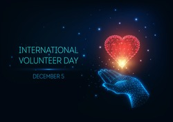 Futuristic glowing low polygonal International Volunteer Day concept with hand holding red heart and text on dark blue background. Modern wire frame mesh design vector illustration.