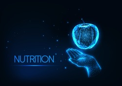 Futuristic healthy diet, nutrition concept with glowing low polygonal human hand holding an apple isolated on dark blue background. Modern wire frame mesh design vector illustration.
