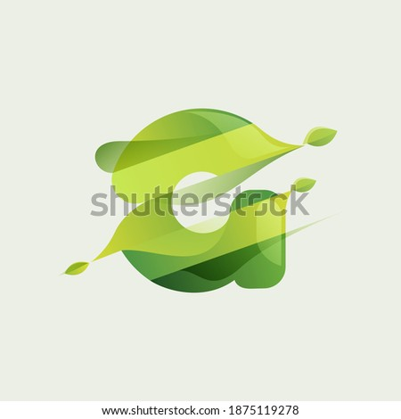G letter eco logo with green diagonal stripes, leaves and waves. Vector font perfect to use in agriculture labels, herbal cards, nature posters, vegan identity, etc. Photo stock ©