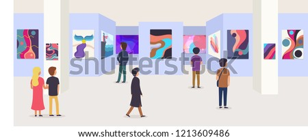 Gallery of modern art with visitors. Abstract paintings hanging on wall in  exhibition or museum room.