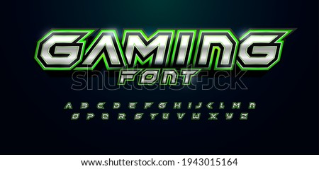 Gaming font for video game logo and headline. Bold futuristic letters with sharp angles and green outline. Tilted sharp font on black background. Modern Vector typography design with metal texture.