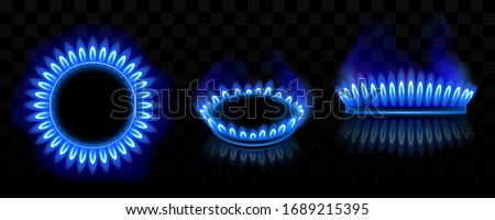 Gas burner with blue flame, glowing fire ring on kitchen stove. Vector realistic mockup of burning propane butane in oven for cooking in top and side view isolated on black background Сток-фото ©