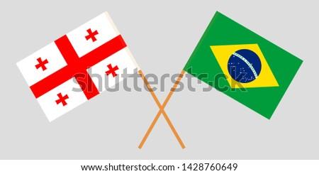 Georgia and Brazil. Crossed Georgian and Brazilian flags