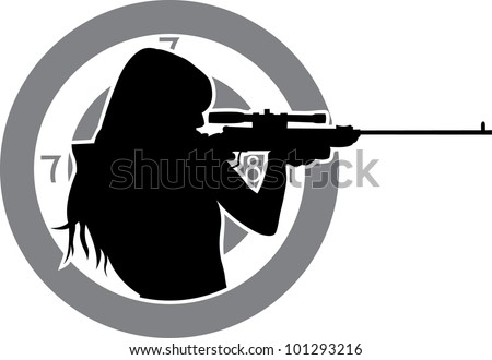 girl aims from a rifle with