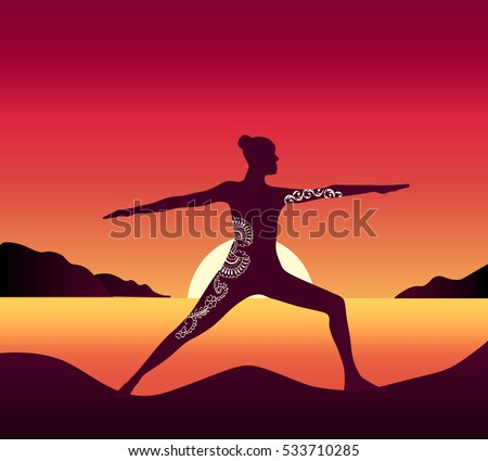 girl does yoga at sunset