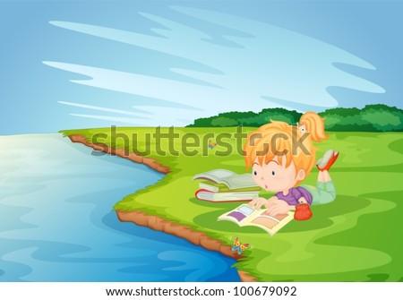 Girl doing homework in the park