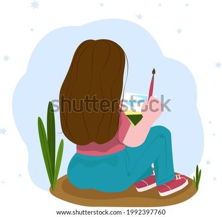 girl draws in watercolor