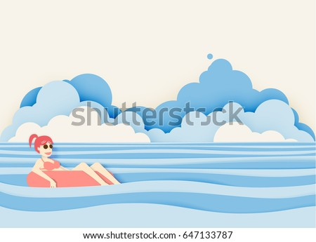 girl floating on the beach with