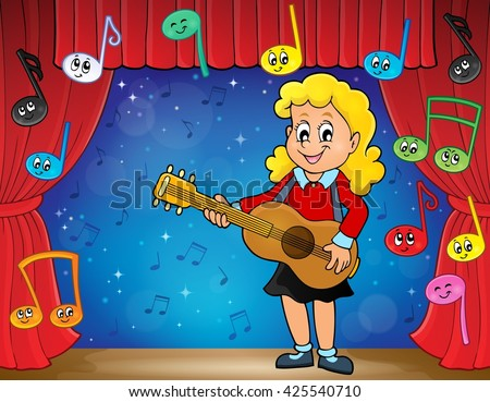 girl guitar player on stage