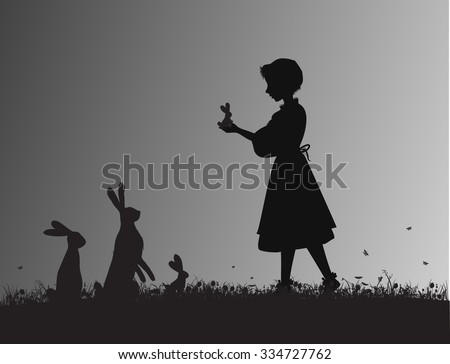 girl holding small hare or