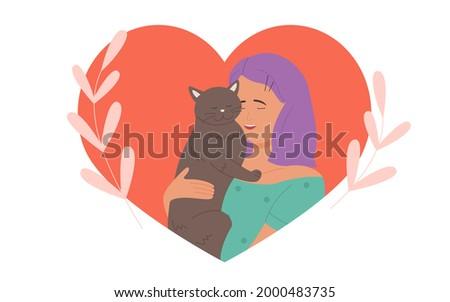 girl hugs cuddles cute cat with
