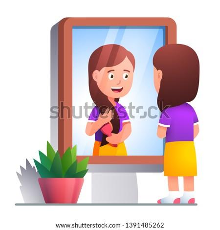 girl kid brushing hair with