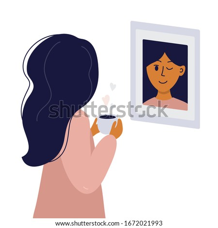 girl looks in mirror and winks