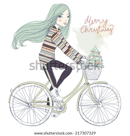 girl on a bicycle with a Christmas tree