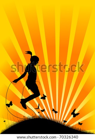 girl playing with a skipping rope on the background of the rising sun;