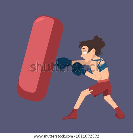 girl punching boxing bag