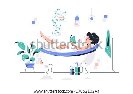 girl relaxing in foam bath with