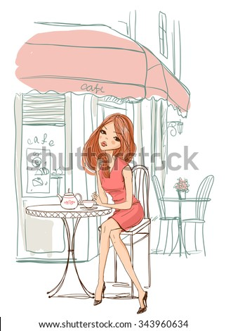 girl sits in a cafe