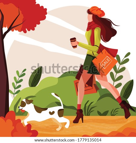 girl walks with dog in park