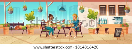 girls seating on cafe terrace