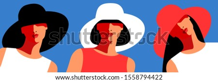 girls wearing big hats three
