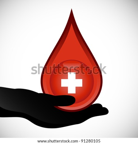 Give blood concept. Hand holding a drop of red blood with white medical cross.