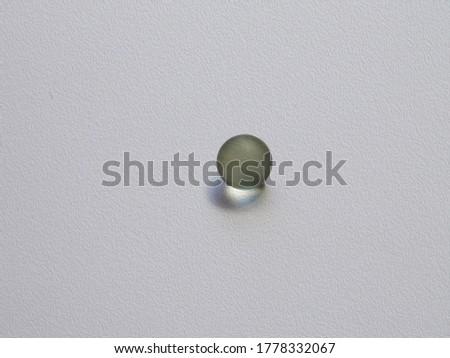 glass balls glowing on a gray