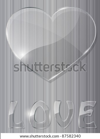 glass heart on metal background