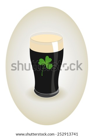 glass of dark beer with shamrock