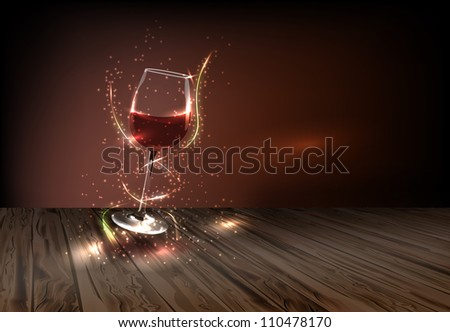 Glass of wine adorned with many small colored lights on a dark background