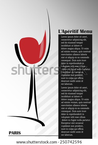glass with red wine on a gray