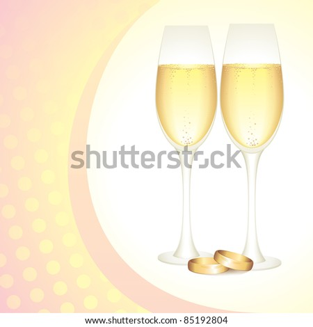 glasses of champagne with gold wedding rings