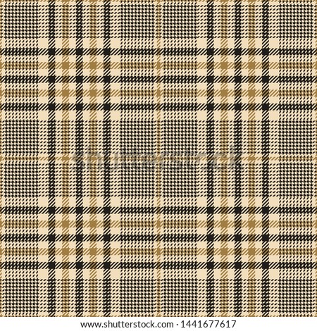 Glen check plaid pattern. Seamless tartan plaid in dark grey and gold for jacket, coat, skirt, trousers, or other modern autumn winter fashion tweed textile print.