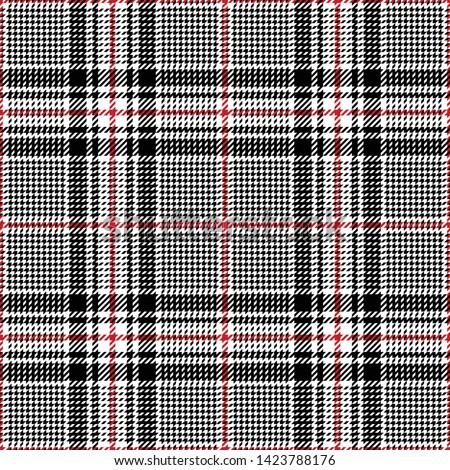 Glen plaid pattern. Seamless classic hounds tooth check plaid in black, red, and white for coat, jacket, or other modern fashion textile design.