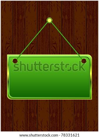 Glossy green signboard on the cord located on dark wooden boards