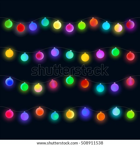 Glowing Christmas lights garland. Colorful matte sphere for design on black background.