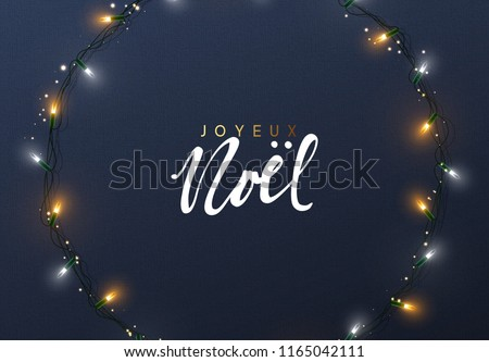 Glowing Christmas lights Wreath for Xmas Holiday greeting cards design. French text Joyeux Noel. (Translation Happy New Year and Merry Christmas)