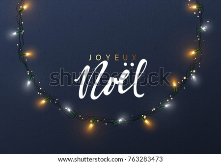 Glowing Christmas lights Wreath for Xmas Holiday greeting cards design. French text Joyeux Noel.