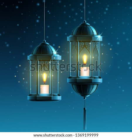 Glowing fanous or vintage fanoos, hanging islam lantern or antique arab light with candle at night. Background symbol or object for ramadan kareem or eid mubarak. Eastern or muslim holiday theme stock photo