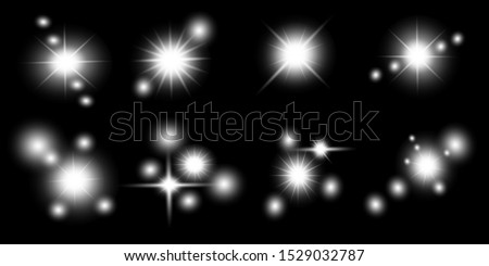 glowing lights effects isolated on black background. Sun flash with rays and spotlight. Glow light effect. Star burst with sparkles.