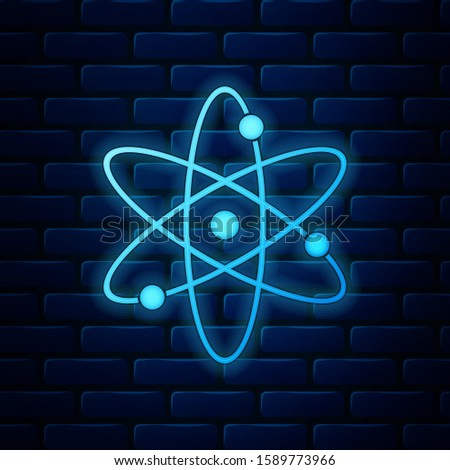 Glowing neon Atom icon isolated on brick wall background. Symbol of science, education, nuclear physics, scientific research. Electrons and protonssign.  Vector Illustration