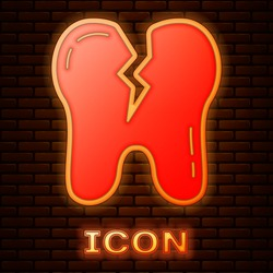 Glowing neon Broken tooth icon isolated on brick wall background. Dental problem icon. Dental care symbol. Vector.